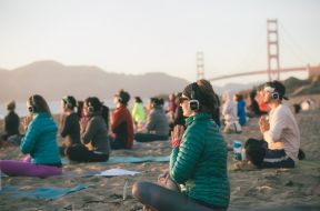 Team Silent Disco Yoga on Baker Beach